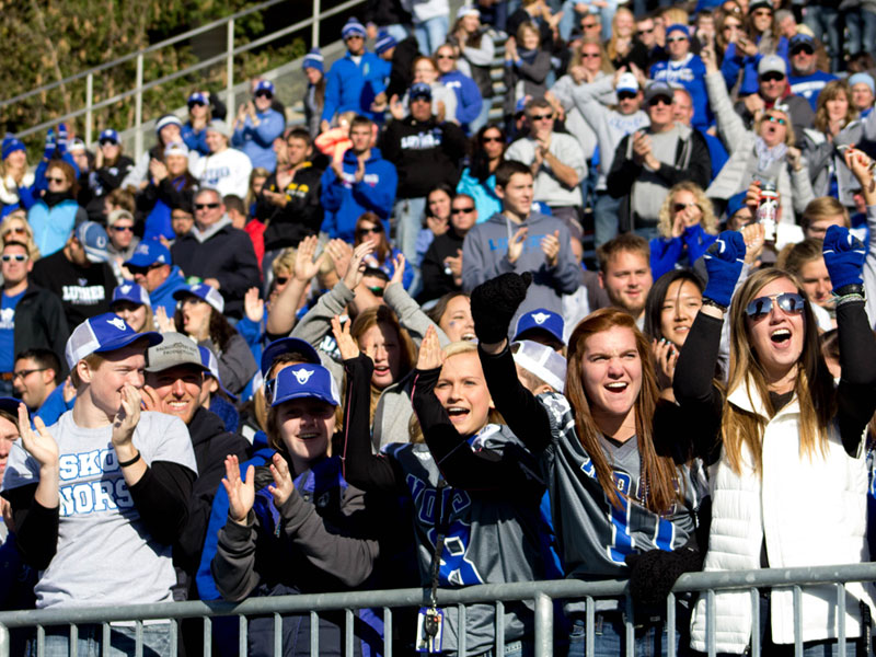 Students cheering at a Luther football game.
